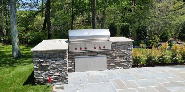 slate outdoor patio and grill